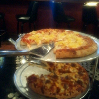 Photo taken at Glass Nickel Pizza by Gabe R. on 4/1/2013