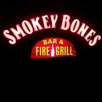 Photo taken at Smokey Bones Bar & Fire Grill by George G. on 9/24/2013