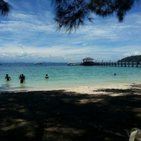 Photo taken at Manukan Island by Ahmad S. on 4/14/2013