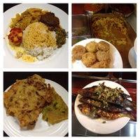 Photo taken at Minang Indonesian Restaurant by Hugo C. on 7/25/2014