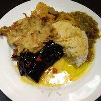 Photo taken at Minang Indonesian Restaurant by Hugo C. on 7/27/2014