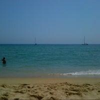 Photo taken at Platja del Pla de Montgat by Fabio M. on 7/21/2013