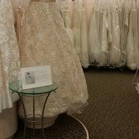 Photo taken at David's Bridal by Mrs T. on 6/21/2014