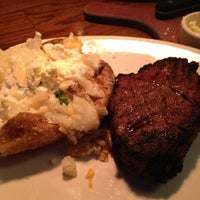 Photo taken at Outback Steakhouse by Lisa R. on 12/27/2012