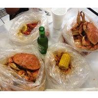 Photo taken at Raging Crab by Rhadames B. on 5/5/2013