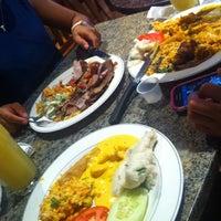 Photo taken at Oliveira's Steakhouse by Merve K. on 8/8/2014