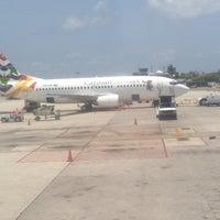 Photo taken at Owen Roberts International Airport (GCM) by Kendra B. on 5/6/2013