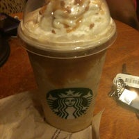 Photo taken at Starbucks by Eliza B. on 5/23/2013
