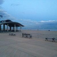 Photo taken at Ocean Parkway Beach by Emir K. on 3/26/2013