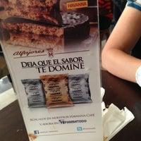 Photo taken at Havanna Café by Oscar E. on 5/26/2013