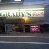 Photo taken at Graby's Mini Mart by Jonathon O. on 5/20/2013
