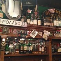 Photo taken at Mollie's Irish Pub by Alexander A. on 6/1/2013