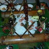 Photo taken at Blackbeard's Seafood Island by Nen M. on 6/26/2013
