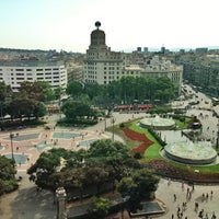 Photo taken at Plaça de Catalunya by Ira K. on 7/8/2013