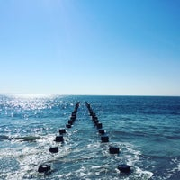 Photo taken at Brighton Beach by Bella B. on 10/19/2016
