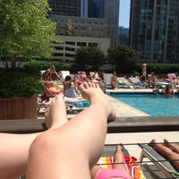 Photo taken at One Superior Place Pool Deck (One W Superior) by Laetitia H. on 6/23/2013