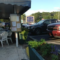 Photo taken at Island Cafe & Deli by Rebecca S. on 6/12/2013