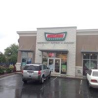 Photo taken at Krispy Kreme Doughnuts by Nedaa B. on 8/1/2014