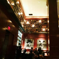 Photo taken at The Library at Hudson Hotel by Nureen G. on 4/5/2015