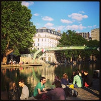 Photo taken at Canal Saint-Martin by Benoit D. on 6/22/2013