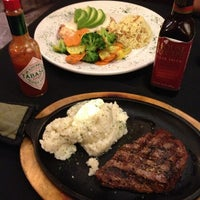 Photo taken at Sweetwater Steakhouse by Bernice D. on 7/10/2013