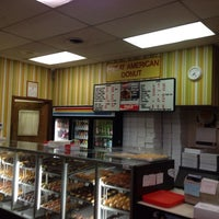 Photo taken at Great American Donut Shop by Adam G. on 3/19/2014