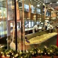 Photo taken at Beecher's Handmade Cheese by Ian G. on 12/1/2012