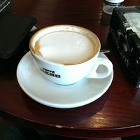 Photo taken at Caffé Nero by Adrian S. on 8/30/2014