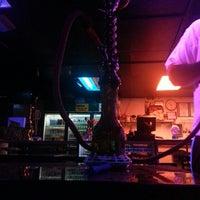 Photo taken at Habibi Hookah Cafe by Jordan K. on 7/9/2013
