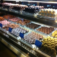 Photo taken at Lindt Chocolat Café by Faith S. on 7/28/2011