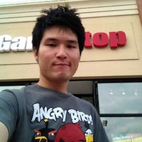 Photo taken at GameStop by Thanade S. on 8/10/2012