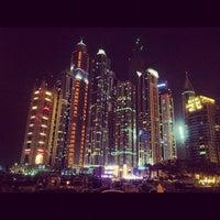 Photo taken at Dubai Marina Walk by Chris W. on 7/28/2012