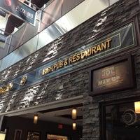 Photo taken at Tigín Irish Pub & Restaurant by Hazel T. on 7/19/2012