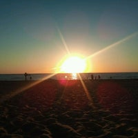 Photo taken at Holland State Park by Andrew M. on 8/7/2012
