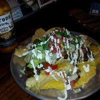 Photo taken at Tomatillo Mexican Grill by christian m. on 11/17/2011