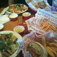 Photo taken at Red Robin Gourmet Burgers by Hannah N. on 10/5/2011