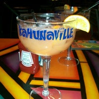 Photo taken at Kahunaville by Kelly P. on 1/30/2012
