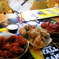 Photo taken at Buffalo Wild Wings by Junior M. on 3/14/2012