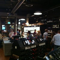 Photo taken at Buzz Wine Beer Shop by Max M. on 6/30/2011