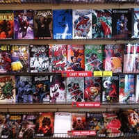 Photo taken at Midtown Comics by Unique B. on 3/30/2012
