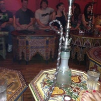 Photo taken at Aloosh Hookah Bar Restaurant by Casey M. on 9/4/2013