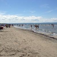 Photo taken at Wasaga Beach by Samuel M. on 7/21/2013