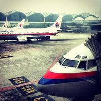 Photo taken at Kuala Lumpur International Airport (KUL) by Derrick L. on 6/24/2013