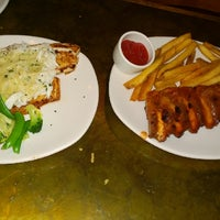 Photo taken at Outback Steakhouse by Amanda L. on 5/4/2014