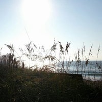 Photo taken at Wrightsville Beach by Seany R. on 7/26/2013