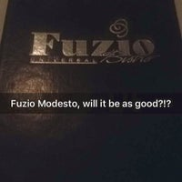 Photo taken at Fuzio Universal Bistro by Marie B. on 12/27/2015
