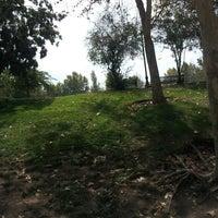 Photo taken at Laguna Parque de Los Reyes by Nok Kine on 3/16/2013