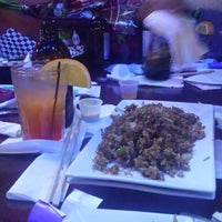 Photo taken at Golden Dragon Bar & Grill by Poet T. on 12/18/2014
