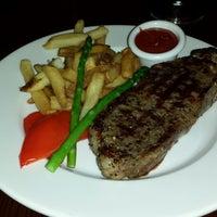 Photo taken at The Keg Steakhouse + Bar - Keg Mansion by Paulo F. on 7/28/2013