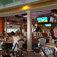 Photo taken at Mulligan's Beach House Bar & Grill by Laurie Lee D. on 6/21/2014